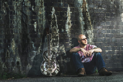 Lawless Luke, Delta Blues Slide Guitar player & composer, sitting down with Michael Messer Lightning Resonator Guitar