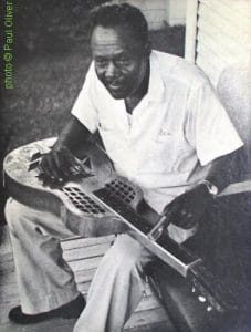 """Black Ace"" 1960, playing a Triplate Squareneck source: Front cover of Arhoolie F 1003; photographer: Paul Oliver"
