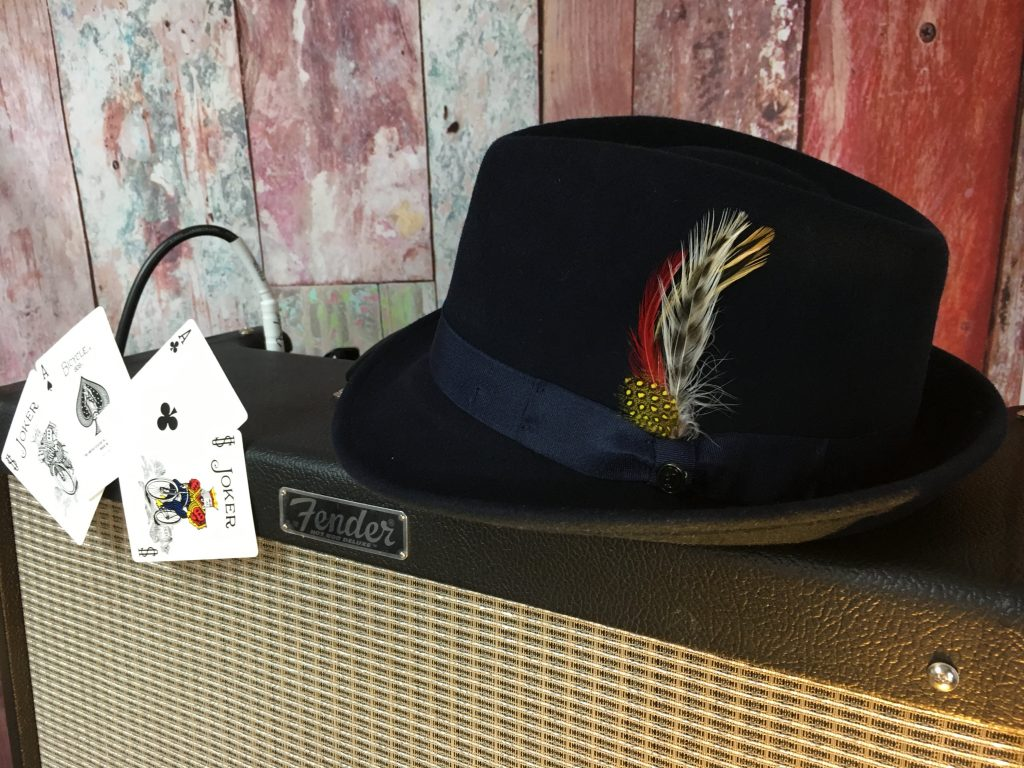 "Lawless Luke Detroit hat with ""The Black Ace Card"" on amp, Delta Blues Slide Guitar player & composer, from Coventry, West Midlands, UK"